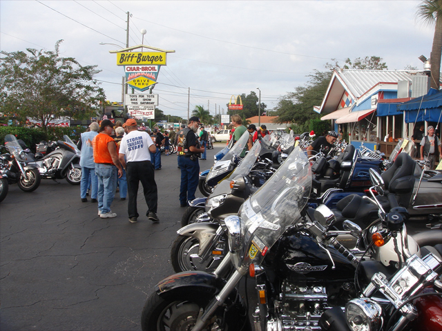 Motorcycles lined the parking lot.